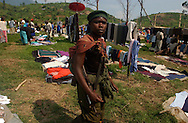 Nyabiondo. Democratic Republic of Congo.   A FDLR rebel soldier shops around the main market in this little town in eastern Congo, considered a stronghold base for these Hutu based rwandan genocidal militia. (Photo by Miguel Juárez Lugo).