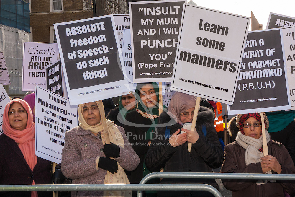 "London, February 8th 2015. Muslims demonstrate outside Downing Street  ""to denounce the uncivilised expressionists reprinting of the cartoon image of the Holy Prophet Muhammad"". PICTURED: Women protest separately from men as demanded by Islamic tradition."