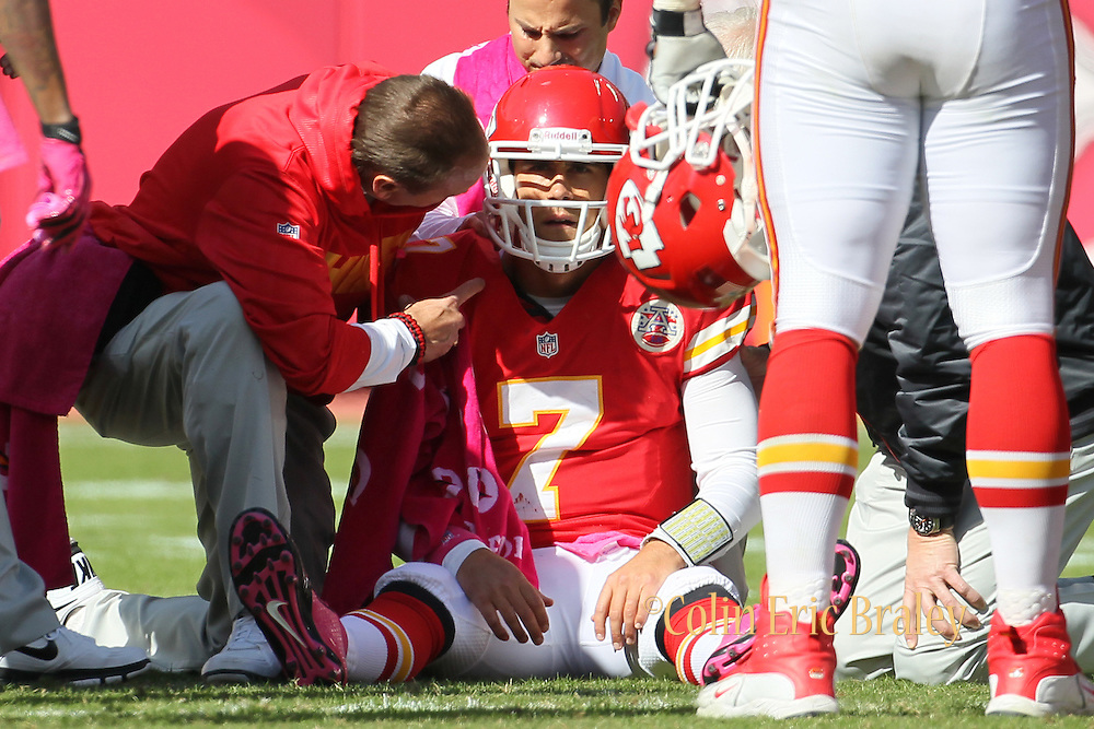 Trainers assist Kansas City Chiefs quarterback Matt Cassel (7) during the second half of an NFL football game against the Baltimore Ravens at Arrowhead Stadium in Kansas City, Mo., Sunday, Oct. 7, 2012. The Ravens defeated the Chiefs 9-6. (AP Photo/Colin E. Braley).