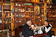 Two men enjoy meal, famous museum-cafe, Ramos Generales, (dates back to Salamon family 1906) , Ushuaia, Argentina.
