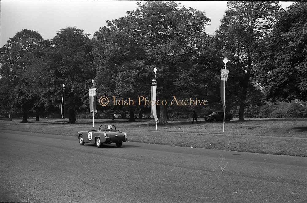 16/09/1967<br /> 09/16/1967<br /> 16 September 1967<br /> Phoenix Park Motor Racing, Kingsway Trophy Race, sponsored by Player and Wills (Ireland) Limited. Image shows C.J. Holohan's M.G. Midget.