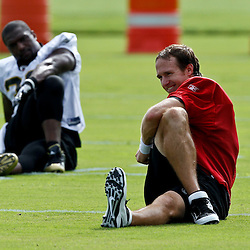 July 29, 2011; Metairie, LA, USA; New Orleans Saints quarterback Drew Brees (9) stretches during the first day of training camp at the New Orleans Saints practice facility. Mandatory Credit: Derick E. Hingle