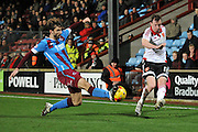 Sheffield United midfielder Martyn Woolford crosses ball blocked by Charlie Goode of Scunthorpe United  during the Sky Bet League 1 match between Scunthorpe United and Sheffield Utd at Glanford Park, Scunthorpe, England on 19 December 2015. Photo by Ian Lyall.