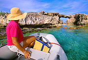 356211-1004 ~ Copyright: George H.H. Huey ~ Natural arch on Hell's Gate Island, a protected islet on the northeast side of the island of Antigua.  Viewed from a visitor's inflatable boat.  Leeward Islands, Caribbean.