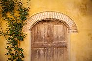 arched doorway in the village of Montforte d'Alba, Piedmonte, Italy