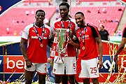 Rotherham United defender Semi Ajayi (5), Rotherham United defender Shaun Cummings (25) and Rotherham United defender Josh Emmanuel (2) celebrating with the trophy after the EFL Sky Bet League 1 play-off final match between Rotherham United and Shrewsbury Town at Wembley Stadium, London, England on 27 May 2018. Picture by Nigel Cole.