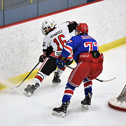 GEORGETOWN, ON - JANUARY 5: Thomas Hernandez #16 of the Georgetown Raiders tries to keep the puck from  Spenser Kersten #77 of the Oakville Blades in the second period on January 5, 2019 at Gordon Alcott Memorial Arena in Georgetown, Ontario, Canada.<br /> (Photo by Ken Lamb / OJHL Images)