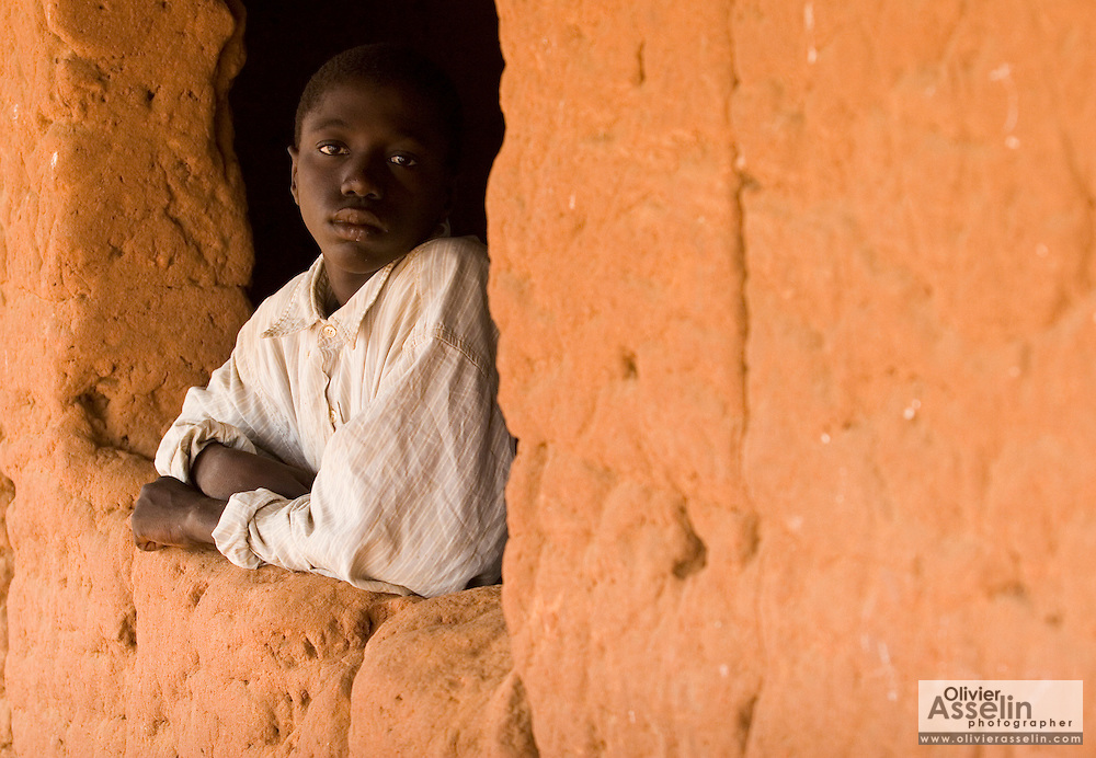 A boy rests in the window of a classroom at the Kabiline I Primary school in the village of Kabiline, Senegal on Wednesday June 13, 2007.