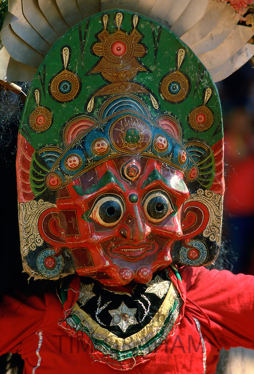 Woman dancer in painted mask,Bhaktapur, Nepal