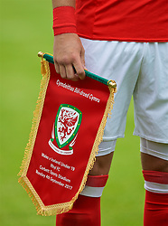 RHYL, WALES - Monday, September 4, 2017: Wales' captain Mitchell Clark holds the FAW match pennant ahead of an Under-19 international friendly match between Wales and Iceland at Belle Vue. (Pic by Paul Greenwood/Propaganda)