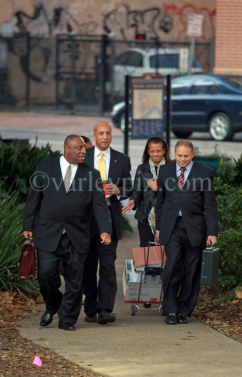 31 January 2014. New Orleans, Louisiana. <br /> Ray Nagin, former mayor of New Orleans walks to Federal court surrounded by his lawyers on the first full day of his corruption trial at the Federal Courthouse. Nagin's wife Seletha accompanies her husband (at Nagin's right). Nagin is charged with 21counts of corruption including  bribery, conspiracy, money laundering and wire fraud. <br /> Photo; Charlie Varley