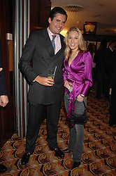 EDWARD TAYLOR and IMOGEN LLOYD WEBBER at an exhibition of photographs by Olivia Buckingham held at China Tang, The Dorchester, Park Lane London on 5th March 2007.<br />
