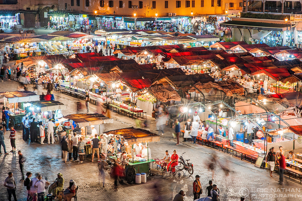 Dusk view of food stalls and crowds in Jemaa El Fna Square in Marrakech, Morocco.