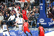 Toronto Raptors  forward OG Anunoby (3) scores on a layup while being guarded by Dallas Mavericks forward Justin Jackson (44) and  Dwight Powell (7) during an NBA basketball game, Saturday, Nov. 16, 2019, in Dallas. The Mavericks defeated the Raptors 110-102. (Wayne Gooden/Image of Sport)