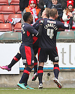 Picture by David Horn/Focus Images Ltd +44 7545 970036.23/02/2013.Billy Clarke (centre)  of Crawley Town celebrates scoring his side's first goal with Mustapha Dumbuya (left) and Mark Connolly (right).during the npower League 1 match at the Matchroom Stadium, London.