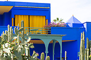 Majorelle Gardens, Marrakesh, Southern Morocco, 2015-04-19.<br /><br />Majorelle Garden is a beautiful twelve acre botanical garden space centred around a vividly painted yellow and blue riad building with Moorish influence to its architecture. Home to exotic plants, tranquil streams with floating lillies and lotus flowers, a large cactus collection and an archaeological museum showcasing a display of Berber culture, the space is named after an expatriate French artist - Jacque Majorelle - who designed the edifice (riad style building) between the 1920's and 1930's.