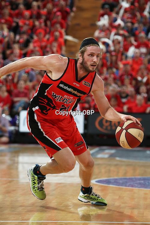 Wildcats Jesse Wagstaff dribbles the ball. Perth Wildcats Vs Adelaide 36ers, NBL Basketball, Perth Arena, PERTH, Western Australia. Sunday, 13 April, 2014. Photo: Travis Hayto / photosport.co.nz