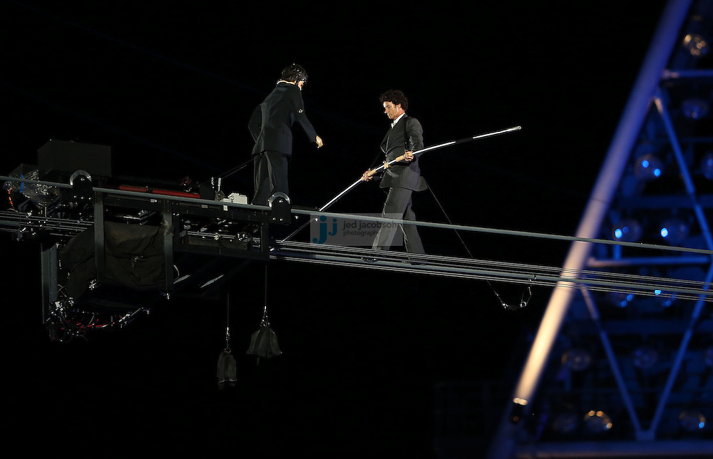 A tightrope walker performs during Closing Ceremonies during day 16 of the London Olympic Games in London, England, United Kingdom on August 12, 2012..(Jed Jacobsohn/for The New York Times)..