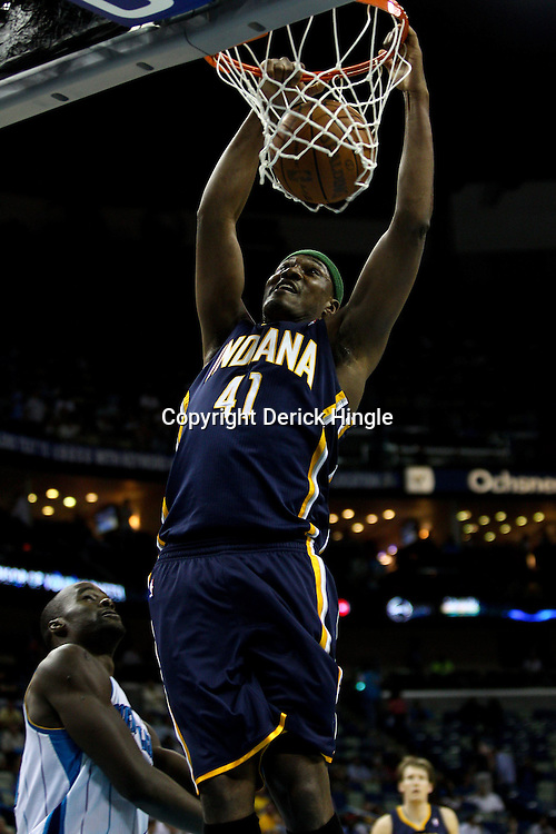 April 3, 2011; New Orleans, LA, USA; Indiana Pacers small forward James Posey (41) dunks over New Orleans Hornets center Emeka Okafor (50) during the fourth quarter at the New Orleans Arena. The Hornets defeated the Pacers 108-96.  Mandatory Credit: Derick E. Hingle