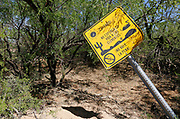 "A warning sign written in Spanish reads ""Watch out! Do not expose your life to the elements. It's not worth it! No drinking water"" on the U.S. - Mexico border on the Tohono O'odham reservation in Chukut Kuk, Arizona April 6, 2017. Picture taken April 6, 2017.  REUTERS/Rick Wilking"