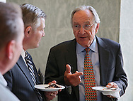 Senator Tom Harkin (D-IA) talks with people at a reception in the Rayburn House Office Building in Washington, DC on Wednesday, April 10, 2013.