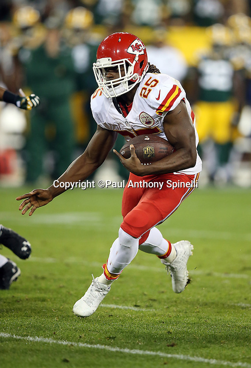 Kansas City Chiefs running back Jamaal Charles (25) runs the ball on a 9 yard run for a second quarter touchdown that cuts the Green Bay Packers lead to 17-7 during the 2015 NFL week 3 regular season football game against the Green Bay Packers on Monday, Sept. 28, 2015 in Green Bay, Wis. The Packers won the game 38-28. (©Paul Anthony Spinelli)