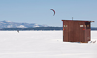 Craig Asher of Long Island, NY enjoys a great day of snow kiting on Lake Winnipesaukee Tuesday afternoon.  (Karen Bobotas/for the Laconia Daily Sun)