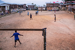 The sun sets over the village Santiaro. The last couple of hours of sun are being used to finish the ongoing football game.