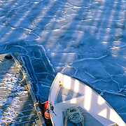Dinghy in the winter ice at a dock in Sprucehead, Maine