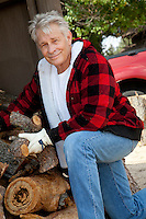 Portrait of senior man working at lumber industry