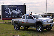 Welcome to Williston ND Boomtown USA. Indeed. This sign on the airport road welcomes new arrivals.<br /> Blaine works CarTunz which specialises in high-end car/truck audio systems and alarms. They have more work than they can comfortably handle, but are not complaining as they are busy.<br /> <br /> North Dakota oil boom. Based around the town of Williston, hydraulic fracturing, also known as 'fracking' has enabled a vast reserve of previously unobtainable oil to be accessed.