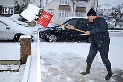 © under license to London News Pictures. 30.11.2010  Early morning snow in kent.  Steve Jefferys clearing his driveway from 3 inchs of snow in Lynton Avenue, St Mary Cray, Orpington, Kent. Picture credit should read Grant Falvey/London News Pictures