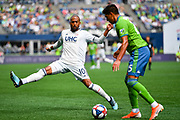 Teal Bunbury #10 of New England Revolution attempts to block Xavier Arreaga #25 of Seattle Sounders pass during a MLS soccer match, Saturday, Aug. 10, 2019, in Seattle.  The teams played to a 3-3 tie. (Alika Jenner/Image of Sport)