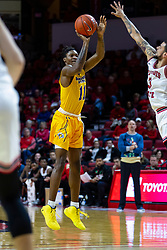 NORMAL, IL - December 07: Julius Dixon launches the long ball over the hand of Ricky Torres during a college basketball game between the ISU Redbirds and the Morehead State Eagles on December 07 2019 at Redbird Arena in Normal, IL. (Photo by Alan Look)