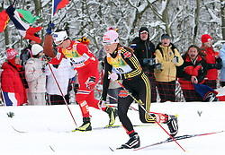 Marit Bjoergen of Norway and Evi Stehle Sachenbacher of Germany at Ladies` Pursuit 7,5 km Classic + 7,5 km Free at FIS Nordic World Ski Championships Liberec 2008, on February 21, 2009, in Vestec, Liberec, Czech Republic. (Photo by Vid Ponikvar / Sportida)