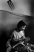 Cigarros H. Uppman, La Habana, Cuba. A woman working and doing manually cuban cigars in the fábrica H.Uppman in Habana.