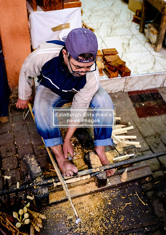 A man carving wooden objects in a traditional manner in the medina in Marrakech, Morocco, North Africa<br /> <br /> (c) Andrew Wilson   Edinburgh Elite media