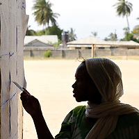 Dar Es Salaam, Tanzania 31 October 2010<br /> A Tanzanian woman checks the voter list in a polling station of Dar Es Salaam during the presidential election day.<br /> The European Union has launched an Election Observation Mission in Tanzania to monitor the general elections, responding to the Tanzanian government invitation to send observers for all aspects of the electoral process.<br /> The EU sent this observation mission led by Chief Observer David Martin, a member of the European Parliament. <br /> PHOTO: EZEQUIEL SCAGNETTI