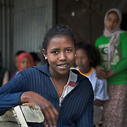 Meseret Mekonin, 18, attends classes at Biruh Tesfa, in Addis Ababa. Biruh Tesfa means bright future in Amharic, and is a program for urban adolescent girls at risk of exploitation and abuse. For many girls, going to Biruh Tesfa is their only hope of an education and a respite from their domestic work. ..The program promotes functional literacy, life skills, livelihoods skills, and HIV/reporductive health education through girls' clubs led by adult female mentors. The girls' clubs are held in meeting spaces donated by the kebele (local administration).