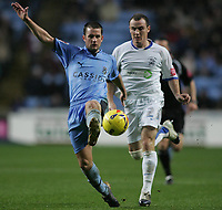 Photo: Lee Earle.<br /> Coventry City v Southend United. Coca Cola Championship. 30/12/2006. Coventry's Michael Doyle (L) battles with Alan McCormack.