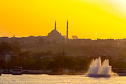 Sunset over Istanbul, Turky as seen from the Bosphorus. A mosque can be seen in the centre