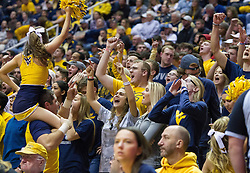 Jan 18, 2017; Morgantown, WV, USA; West Virginia Mountaineers students cheer during overtime against the Oklahoma Sooners at WVU Coliseum. Mandatory Credit: Ben Queen-USA TODAY Sports