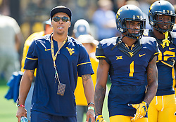 Sep 10, 2016; Morgantown, WV, USA; Former West Virginia Mountaineers player Stedman Bailey talks with West Virginia Mountaineers wide receiver Shelton Gibson (1) before the game at Milan Puskar Stadium. Mandatory Credit: Ben Queen-USA TODAY Sports