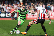 Forest Green Rovers Lee Collins(5) takes on Cheltenham Town's Harry Pell(7) during the EFL Sky Bet League 2 match between Cheltenham Town and Forest Green Rovers at LCI Rail Stadium, Cheltenham, England on 14 April 2018. Picture by Shane Healey.