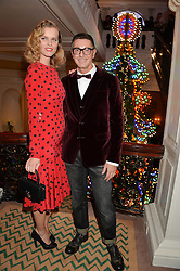STEFANO GABBANA and EVA HERZIGOVA at the Claridge's Christmas Tree By Dolce & Gabbana Launch Party held at Claridge's, Brook Street, London on 26th November 2013.