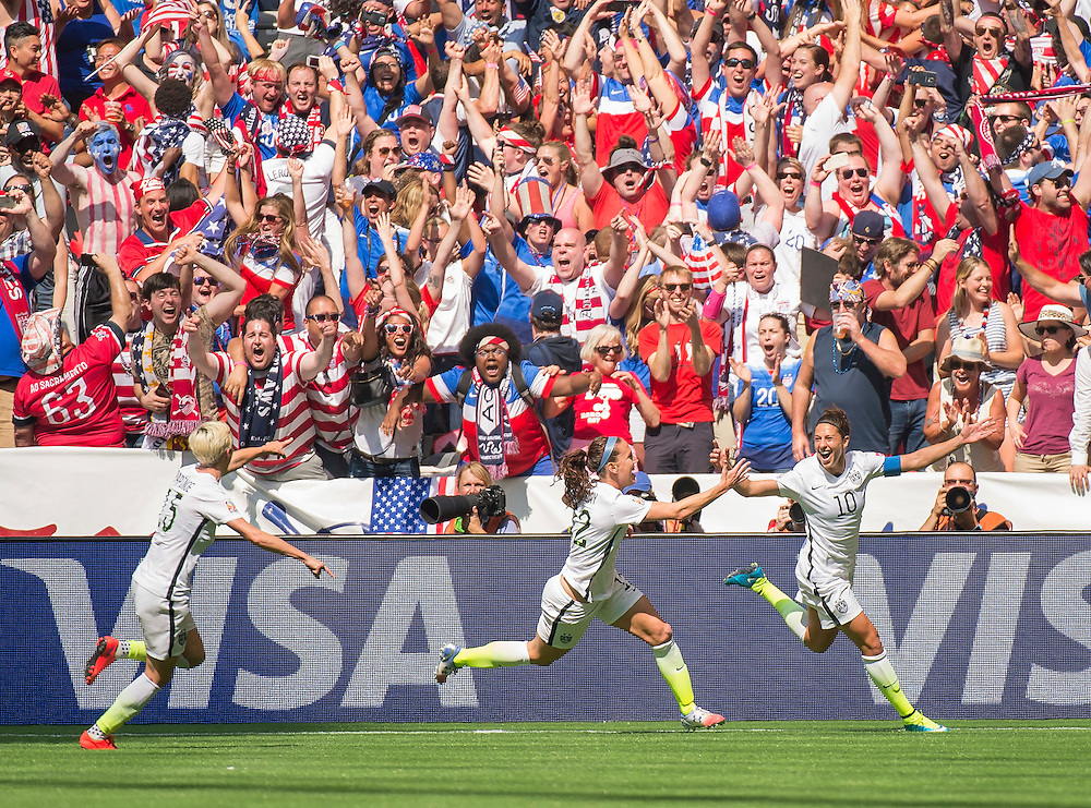 Carli Lloyd of team USA (right #10) celebrates her second goal with team-mates Lauren Holiday (middle) and Megan Rapinoe (left) during 2015 women's World Cup Soccer in Vancouver during the final between USA and Japan.