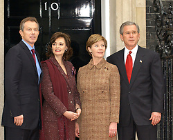 File photo dated 20/11/03 of the then Prime Minister Tony Blair and his wife, Cherie (left) , standing with the then US President George Bush and his wife, Laura, outside Downing Street, ahead of talks during the president's state visit to the UK. Donald Trump???s state visit to the UK is only the third by a US president.