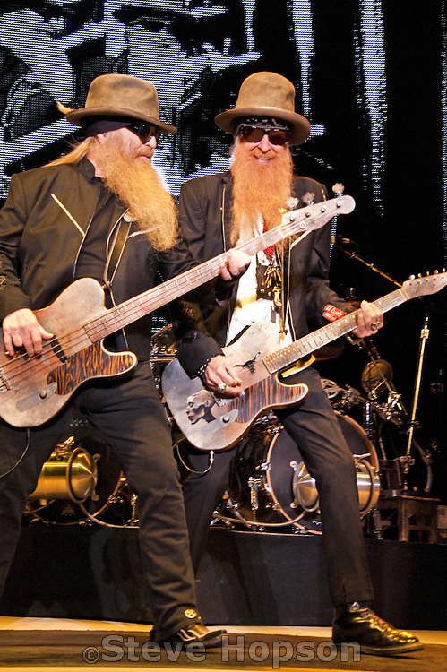 ZZ Top performing at The Backyard, Austin, Texas, October 27, 2012. ZZ Top is an American rock band from Houston, Texas. Formed in 1969, the group consists of Billy Gibbons (guitar and vocals), Dusty Hill (bass and vocals), and Frank Beard (percussion).