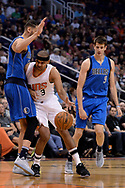 Apr 9, 2017; Phoenix, AZ, USA; Phoenix Suns forward Jared Dudley (3) runs into Dallas Mavericks center Salah Mejri (50) as forward Nicolas Brussino (9) looks on in the first half of the NBA game at Talking Stick Resort Arena. Mandatory Credit: Jennifer Stewart-USA TODAY Sports