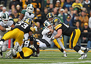 November 12, 2011: Michigan State Spartans quarterback Kirk Cousins (8) is sacked by Iowa Hawkeyes defensive lineman Broderick Binns (91) and Iowa Hawkeyes defensive lineman Thomas Nardo (87) during the second half of the NCAA football game between the Michigan State Spartans and the Iowa Hawkeyes at Kinnick Stadium in Iowa City, Iowa on Saturday, November 12, 2011. Michigan State defeated Iowa 37-21.